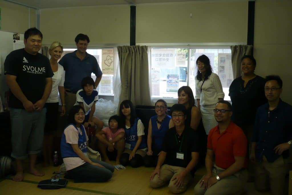 Delegates visit an NPO working in temporary housing units in Ofunato.